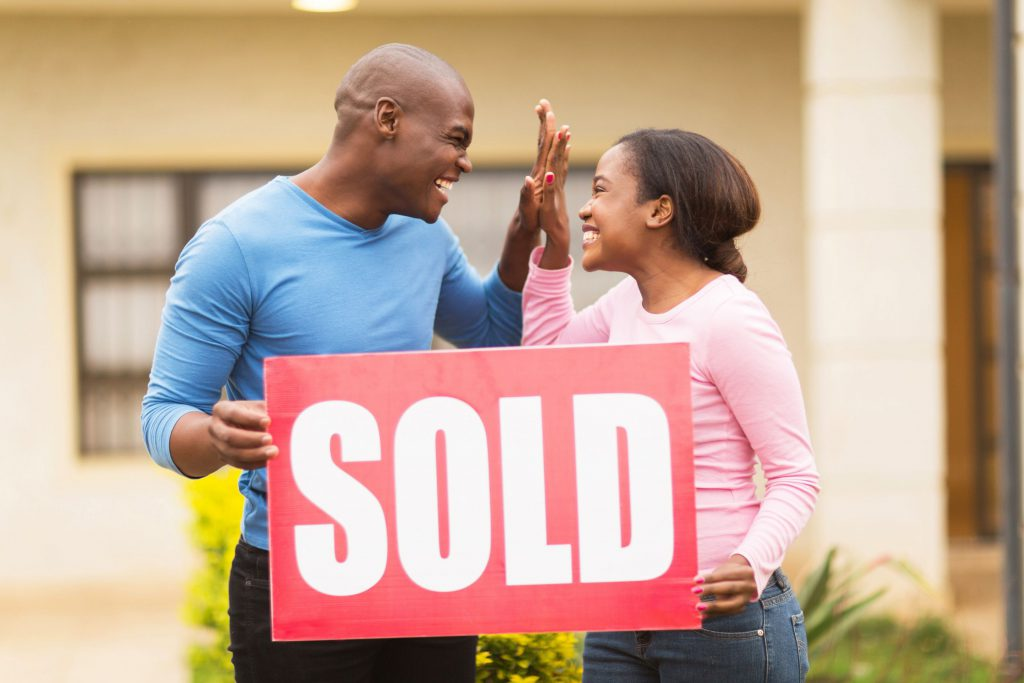 cash offer on house happy couple